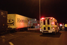 An ambulance waits near the scene of a crash involving a passenger car and a train in Morrinsville. Photo / Christine Cornege