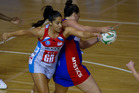 Mystics goal shoot Catherine Latu (right) snatches the ball from the Swifts' Mo'onia Gerrard in their tight tussle in Auckland last night. Photo / Sarah Ivey