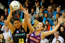 Magic Goal Attack Julianna Naoupu and Firebirds Centre Elissa Macleod fight for the ball. Photo / Christine Cornege