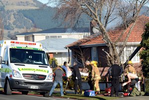 "A witness saw two teenagers run out, one ""on fire screaming"", after the explosion yesterday at this Mosgiel house.  Photo / Otago Daily Times"