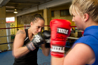 Boxer Daniella Smith, sparring with Hayley Holt, owns Auckland's Boxing Alley gym and has made boxing her life. Photo / Kellie Blizard