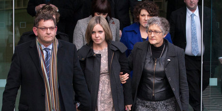 Bryan Guy, with his daughter Anna MacDonald and wife Joanne Guy walk from the High Court in Wellington  after Ewen MacDonald was found not guilty of the murder of Scott Guy. Photo / Guy Bowker