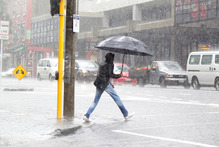 It's wet, wet, wet as Auckland is pelted during the storm. Photo / Richard Robinson.