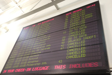 The departure board at Auckland Airport today showing cancelled flights due to the fog. Photo / Sarah Ivey 