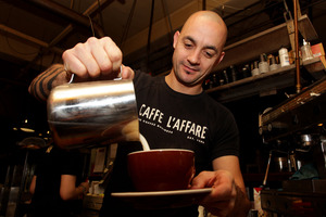 Caffe L'Affare's manager, Jason Casson, makes a flat white. Photo / Hagen Hopkins
