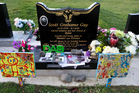 Messages on Scott Guy's grave in Feilding from Kylee Guy and their sons, Hunter and Drover. Photo / Herald on Sunday