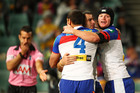 The Knights celebrate a McMaunus try. Photo / Getty Images