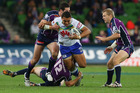 Josh Papalii takes the ball up for the Raiders in Melbourne last night. Photo / Getty Images
