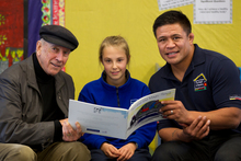 Winning story writer Holly Fisher, 10, with children's author John Parker (left) and All Black Keven Mealamu.  Photo / Brett Phibbs