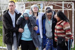 Richard Tairua's grieving relatives at the scene. Photo / Doug Sherring