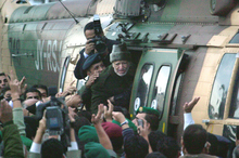Palestinian leader Yasser Arafat boarding a Jordanian Air Force helicopter in October 2004 just before his three-week illness and death. Picture / AP. 