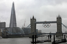 A view of the iconic Tower Bridge, right, over the river Thames, right, and The Shard, left, a newly-constructed high-rise building that is western Europe's tallest, in London. Photo / AP