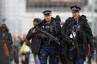 British police on patrol ahead of the Olympic Games later this month. Up to 6000 officers may be axed in cutbacks to the service across the country. Picture / AP