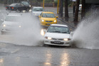 Motorists on the CBD's Mayoral Drive, got a free hubcap wash. Photo / Richard Robinson