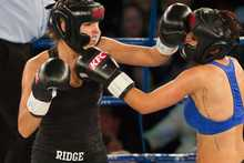New Zealand celebrities Jaime Ridge and Rosanna Arkle fight. Photo / AP.