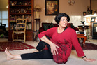 Dr Frances Pitsilis, a personal and corporate physician, relaxes at home with some yoga stretching. Photo /  Janna Dixon