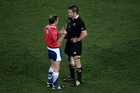 Alain Rolland lays down the law to Richie McCaw during the 2011 Rugby World Cup. Photo / Richard Robinson