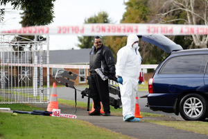 Police forensic officers at the scene where Mr Tairua died. Photo / Doug Sherring