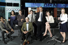The cast for the new Aaron Sorkin series 'The Newsroom' includes Jeff Daniels (third from right) and Emily Mortimer (second from right). Photo / AP