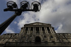 The Bank of England says it will purchase 50 billion pounds of assets with newly created money. Photo / AP