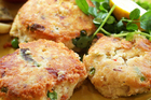 Garlic mayonnaise and kumara wedges go perfectly with smoked fish cakes. Photo / Doug Sherring