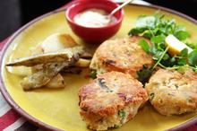 Garlic mayonnaise and kumara wedges go perfectly with smoked fish cakes. Photo / Doug Sherring