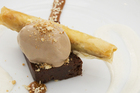 Cibos Valrhona chocolate terrine, milk chocolate mousse and sesame toffee and baklava straw. Photo / Greg Bowker