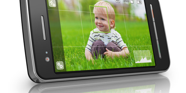 Smartphones are good for taking pictures of the children, but do they take up valuable family time? Photo / Thinkstock