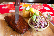 Chihuahua's half-slab of ribs - the accompanying corn with parmesan chilli was inventive. Photo / Kellie Blizard