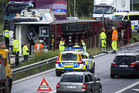 Police work to clear the motorway after one of Madonna's tour trucks crashed in Sweden. Photo / AP