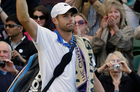 Andy Roddick of the United States gestures to the crowd after losing to David Ferrer of Spain at Wimbledon. Photo / AP