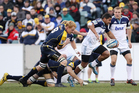 Charles Piutau splits weak Brumbies defence. Photo / Getty Images
