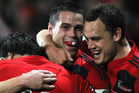 Sean Maitland (C) of the Crusaders is hugged by team mates Zac Guildford (L) and Israel Dagg (R) after scoring a try during the round 18 Super Rugby match. Photo / Getty Images.