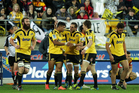Julian Savea of the Hurricanes is congratulated on his try by teammates Andre Taylor and Beauden Barrett during the Super Rugby round 18 game. Photo / Getty images.