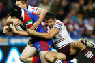 Joel Edwards of the Knights is tackled by Anthony Watmough of the Sea Eagles. Photo / Getty Images.