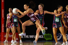 Temepara George of the Mystics and Chelsey Tregear of the Vixens compete for the ball during the Major Semi Final ANZ Championship match. Photo / Scott Barbour.