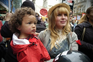 Minke Botes and 2-year-old Luca Namoa join 3000 protesters in Auckland City. Photo / Jason Dorday