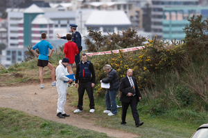 Police at the scene where the body of a woman was discovered on Mt Victoria yesterday. Photo / Mark Mitchell