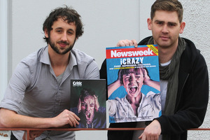 Critic designer Sam clark and editor Joe Stockman with their magazine covers. Photo / Otago Daily Times