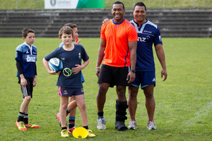 David Raikuna, left, and Pauliasi Manu run drills for the youngsters yesterday.  Photo / Richard Robinson