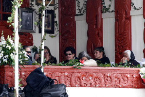 Relatives and kuia keep watch over the coffin on the porch of the meeting house at Waihi Marae near Turangi. Picture / Christine Cornege