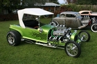 Iridescent green paint with lace flames, chrome plating throughout and an exposed Ford V8 engine make Vandal - built in the late 1960s - a star of the hot rod display at Speedshow.  Photo / Greg Stokes, NZ Hot Rod Magazine