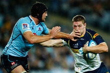 Michael Hooper (right) fends Dean Mumm. Photo / Getty Images