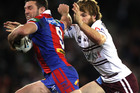 Danny Buderus breaks clear for the Knights. Photo / Getty Images