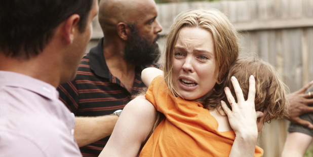 Mum Rosie (Melissa George) protects her son Hugo (Julian Mineo) during an episode of 'The Slap'. Photo / Supplied