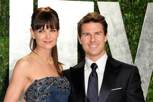 Katie Holmes and Tom Cruise who are calling it quits after five years are keeping the details of their divorce quiet. File Photo / AP