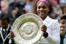 Serena Williams with the trophy after defeating Agnieszka Radwanska of Poland to win the women's final match at the All England Lawn Tennis Championships at Wimbledon. Photo / AP