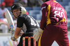 BJ Watling (72 not out) drives a ball past West Indies wicket keeper Denesh Ramdin. The kiwis were bowled out for 260 off 47 overs. Photo / AP