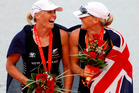 Rowers Georgina (left) and Caroline Evers-Swindell with their gold medals won in Beijing. Picture / Kenny Rodger.