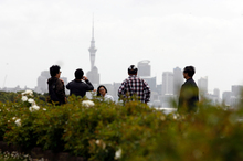 Touirists take in the sites of Auckland. New Tourism Industry Assn head Martin Snedden says the NZ tourism industry needs to adapt to different expectations of visitors from Asia. Photo / Dean Purcell